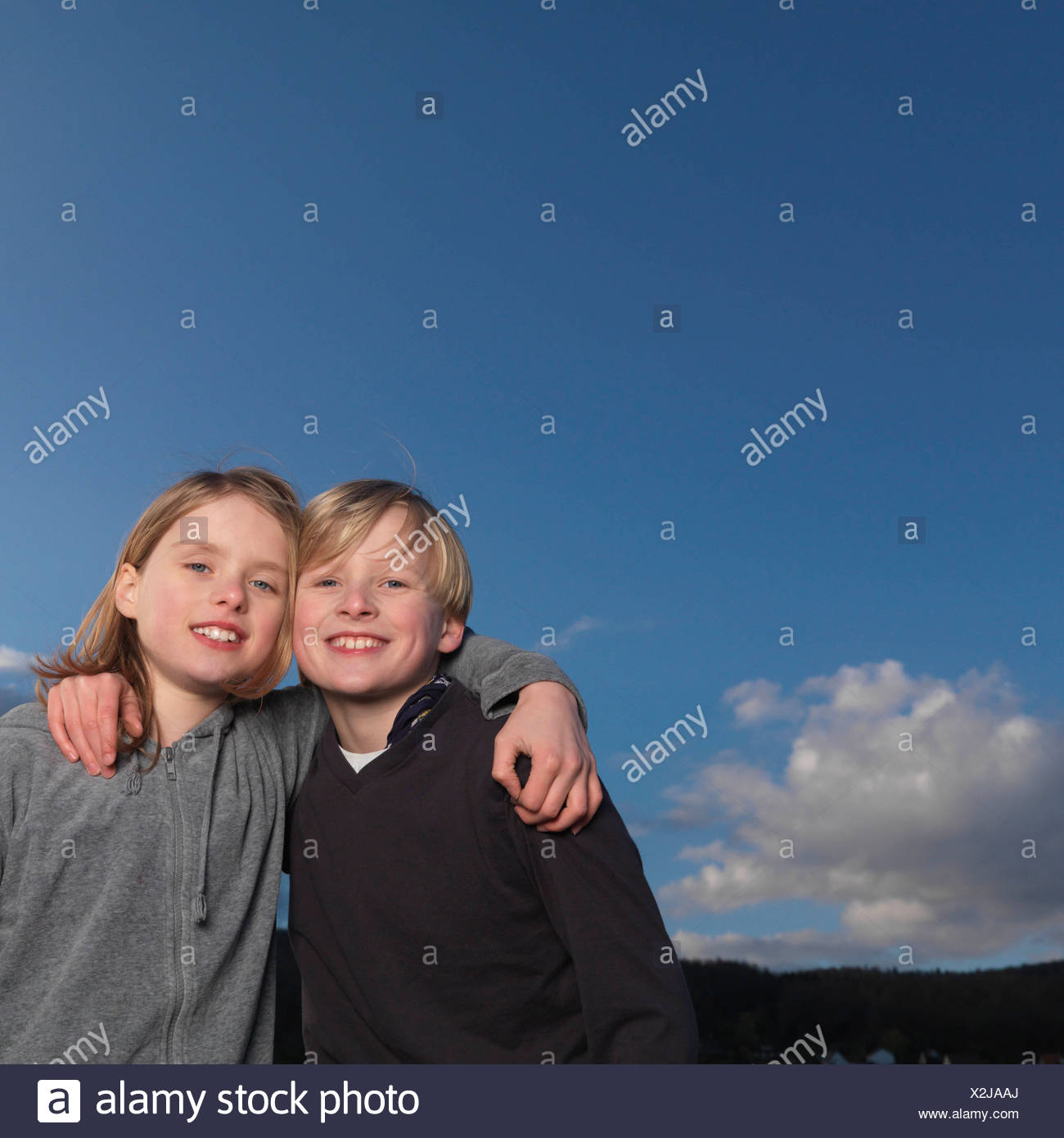 Boys standing with arms crossed - Stock Image