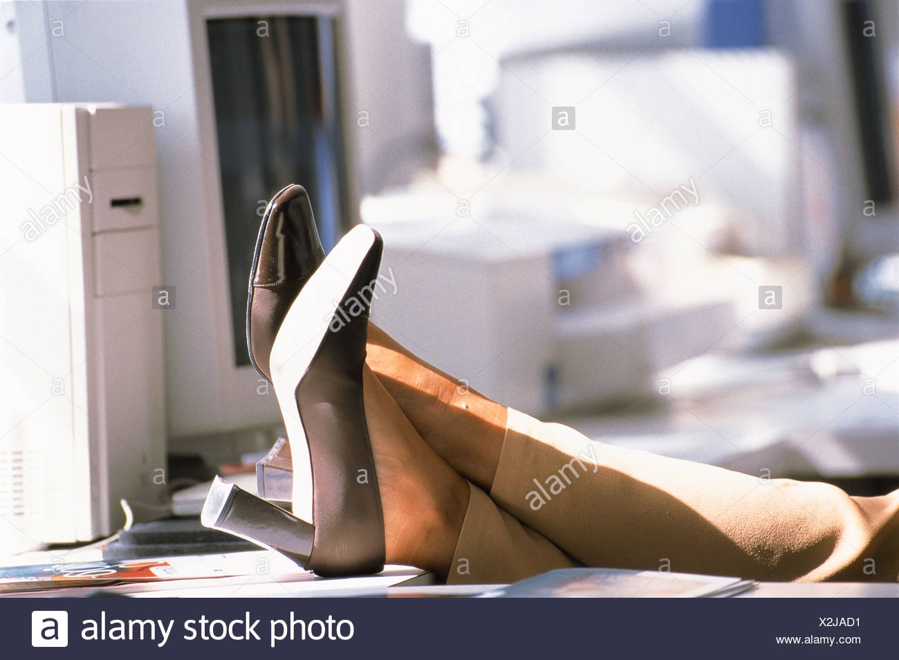 dd78c4947440f9 BUSINESSWOMAN WITH HER FEET UP ON THE DESK Stock Photo  276998541 ...