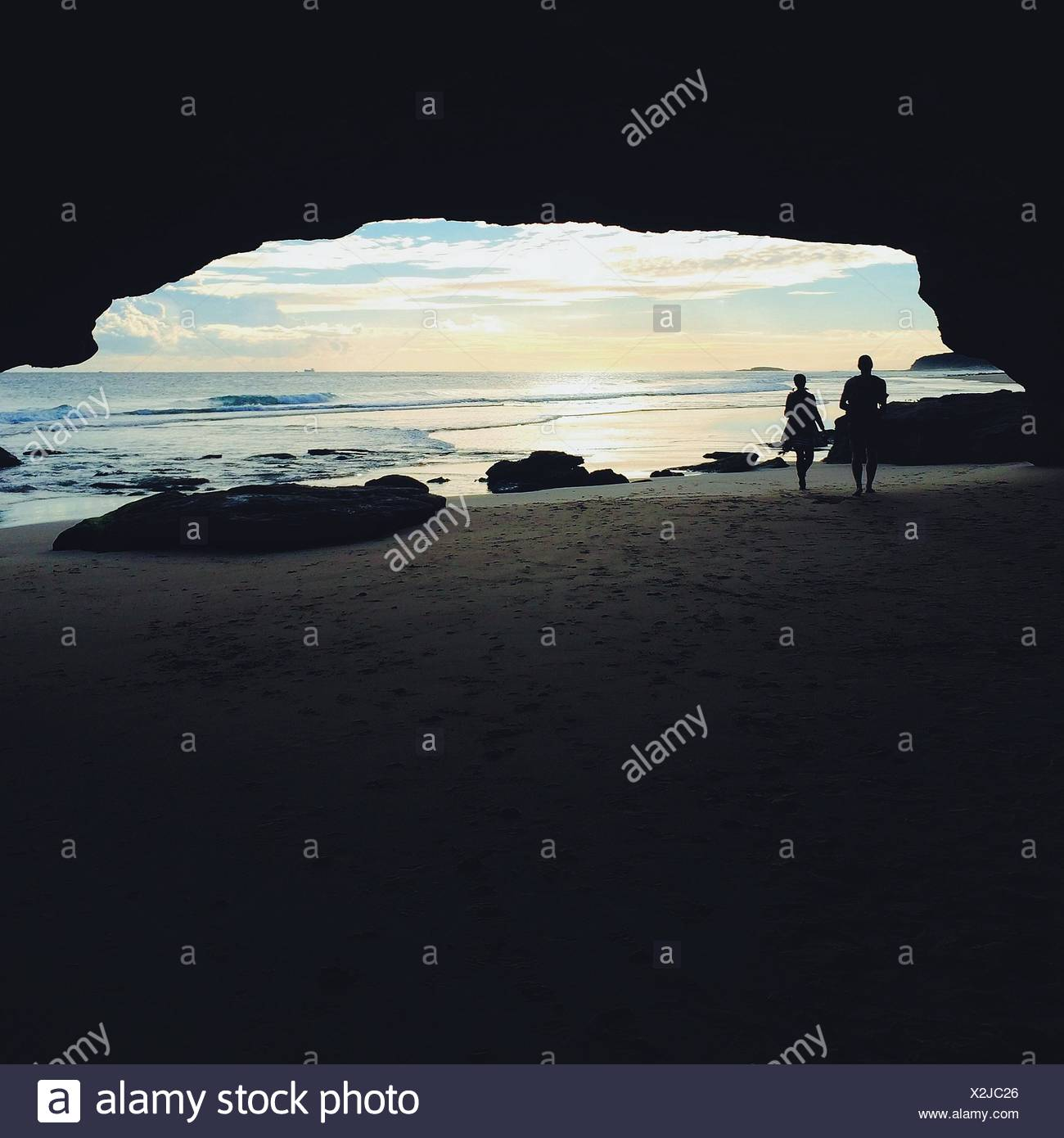 Rear View Of Couple Overlooking Calm Sea - Stock Image