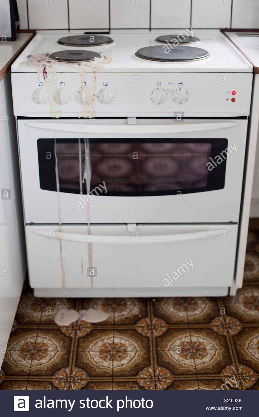 High angle view of filthy stove - Stock Image