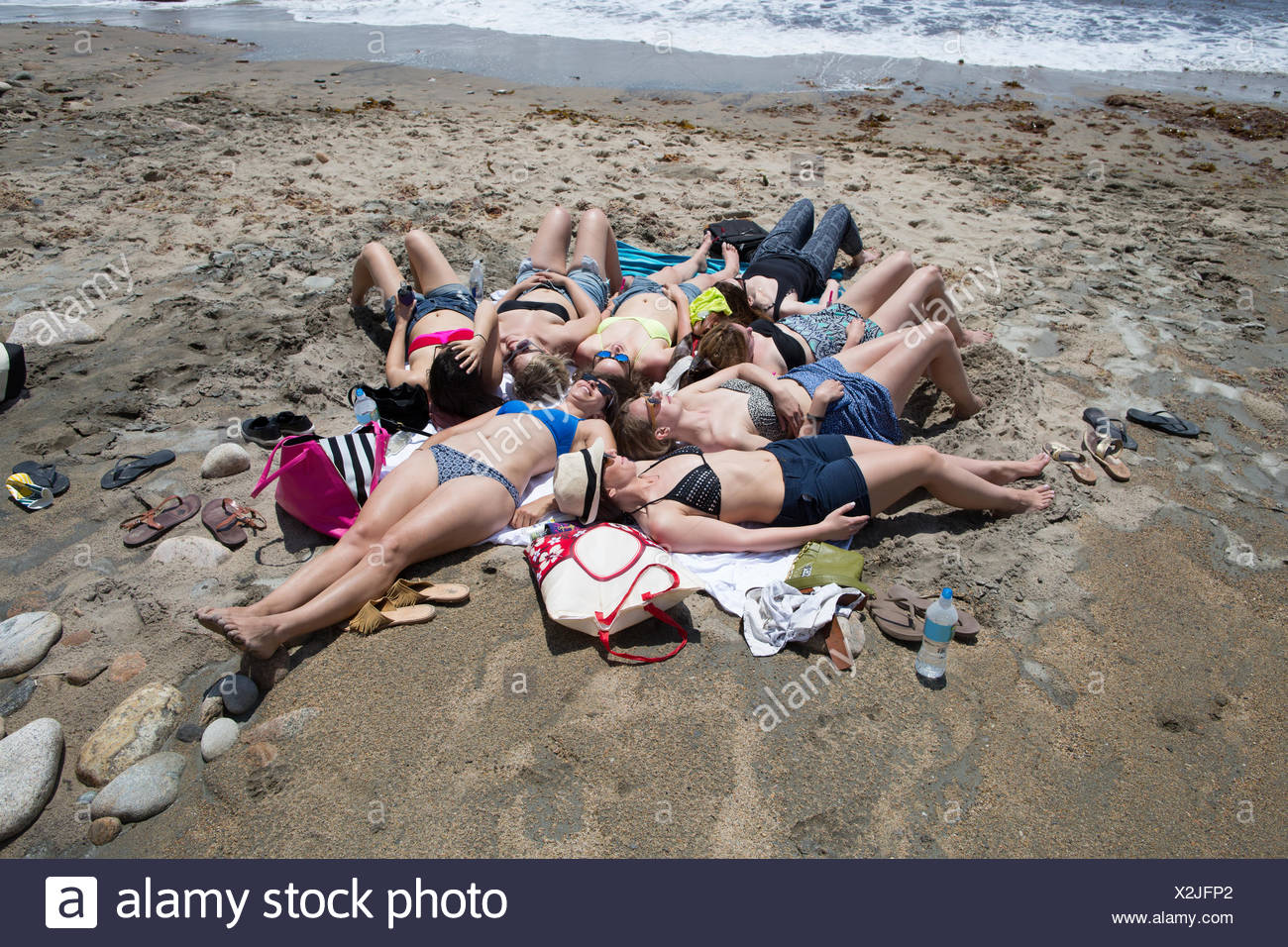 Group of young women sunbathing on beach, Block Island, Rhode Island, USA - Stock Image