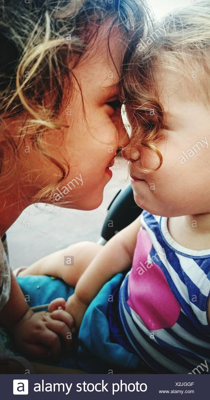 Close-Up Of Boy Embracing Sister - Stock Image