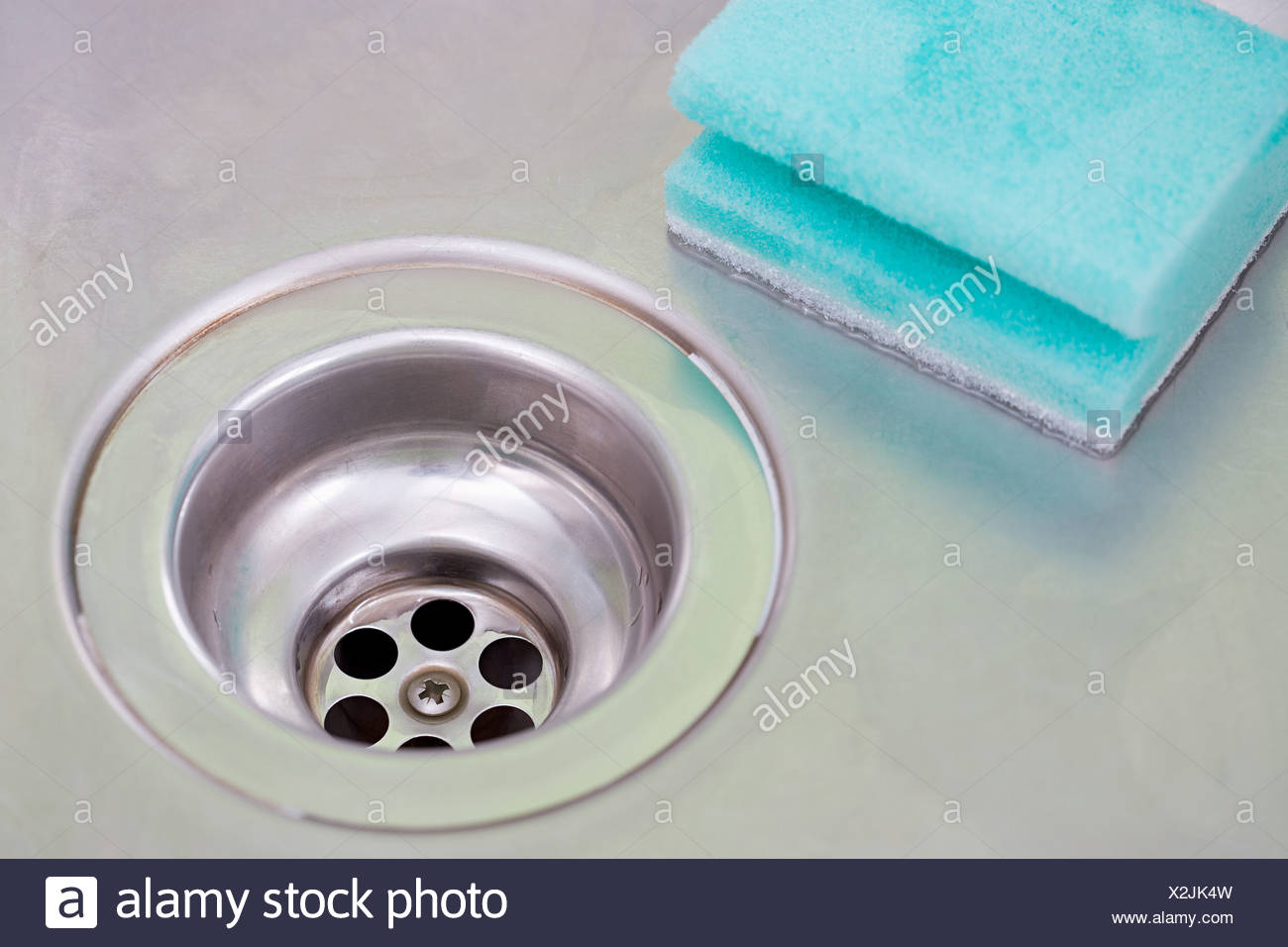 Plug hole and sponge - Stock Image