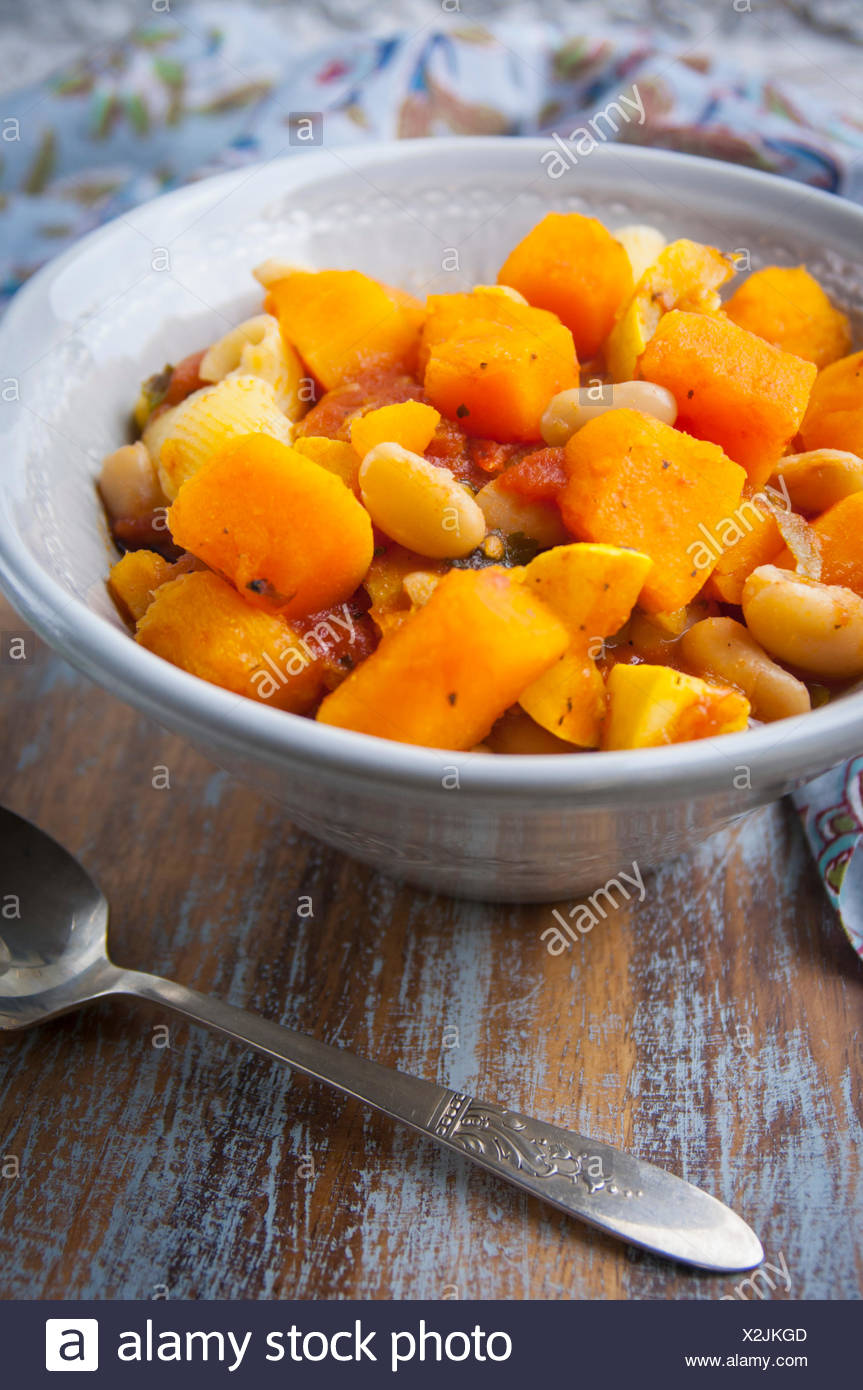 A Close Up View of a Bowl of Vegan Butternut Squash Stew Stock Photo