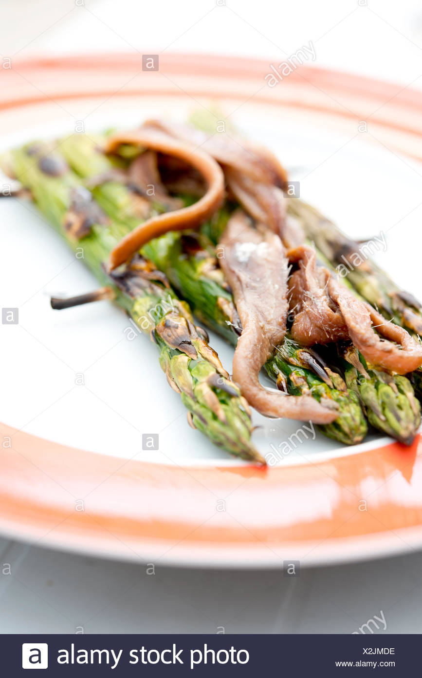 Asparagus, grilled, anchovies, - Stock Image