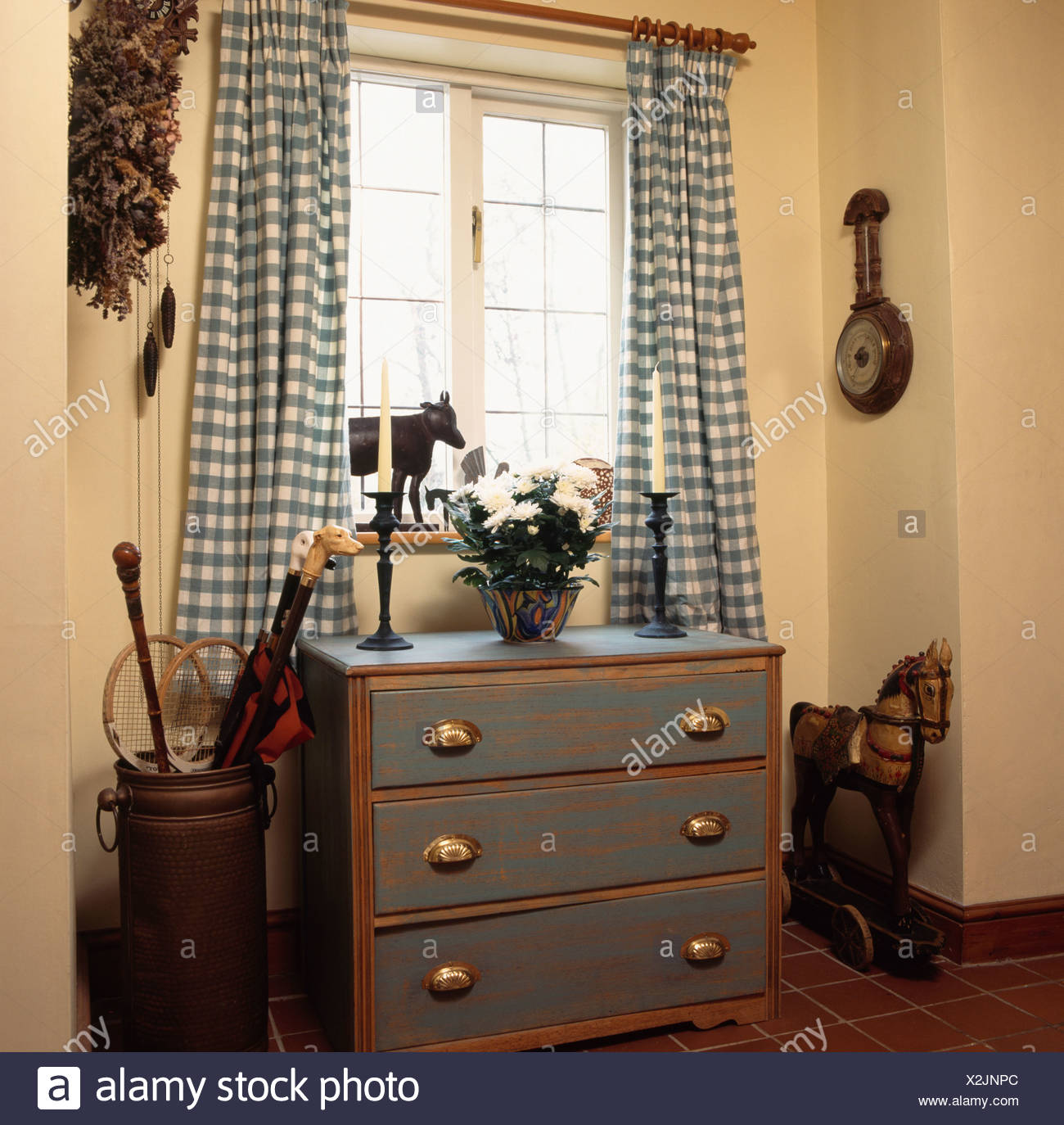 Blue Checked Curtains On Window Above Blue Chest Of Drawers With Distressed  Paint Effect In Small