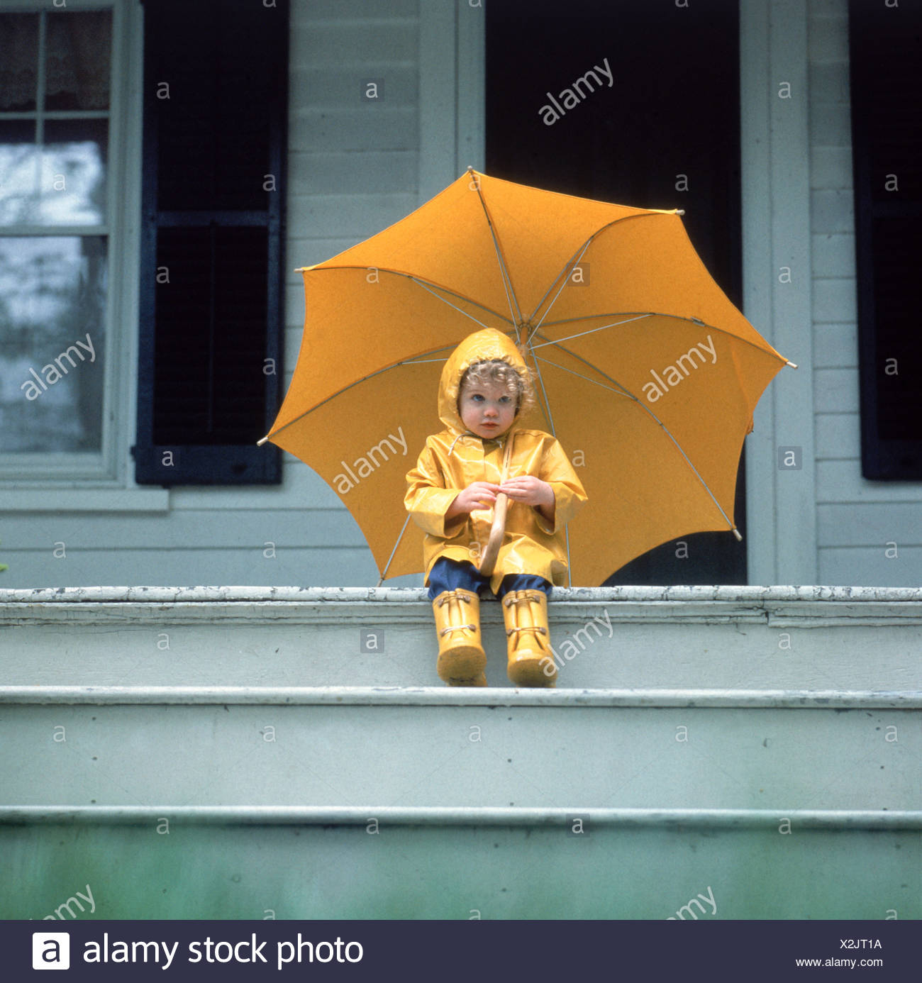 Front Porch Of Yellow House Stock Photo: Girl Holding Umbrella Houses Stock Photos & Girl Holding