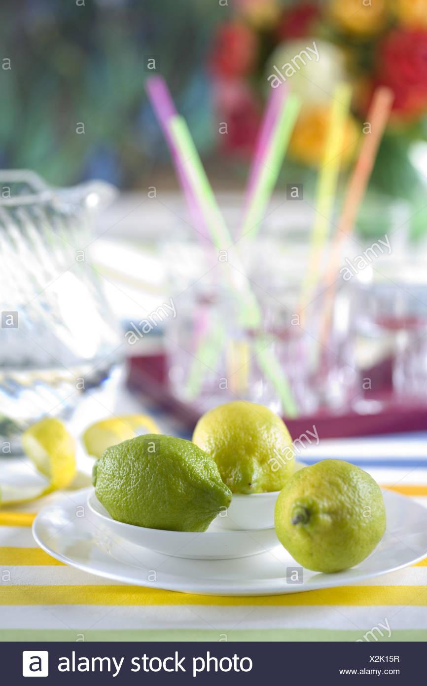 Lemons on white plates, - Stock Image