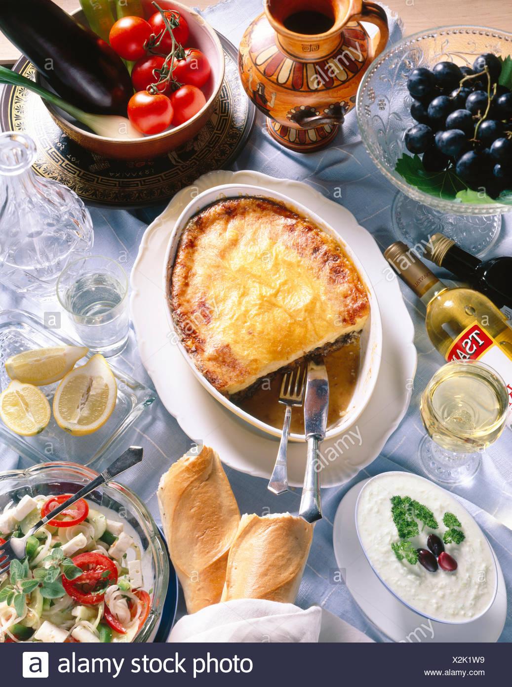 Greek national cuisine, salad with feta cheese, tzatziki, moussaka, Retsina wine - Stock Image