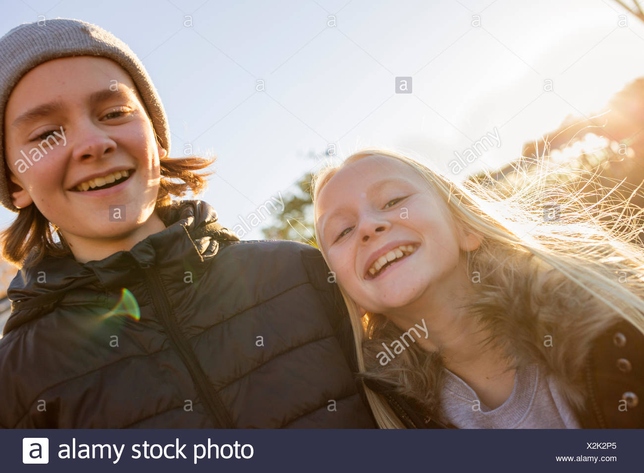 Brother and sister smiling - Stock Image