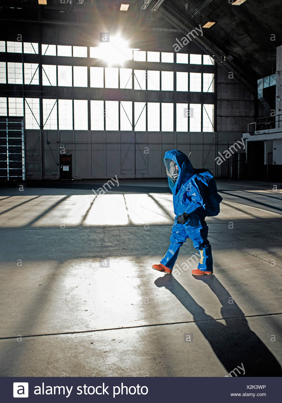 A National Guardsman in nuclear radiation suit walks along at an air base in South Dakota. - Stock Image