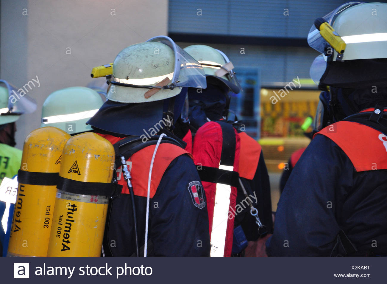 Firefighters,respiration protection,fire brigade,rescue,delete,fire,fire,occupation,life rescue,human rescue,person,helmets,people,men, - Stock Image