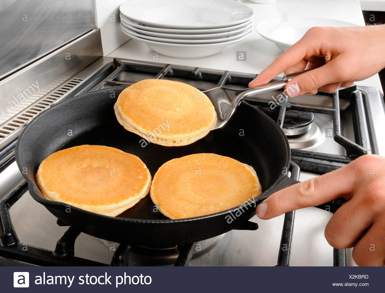 COOKING PANCAKES OR HOTCAKES - Stock Image