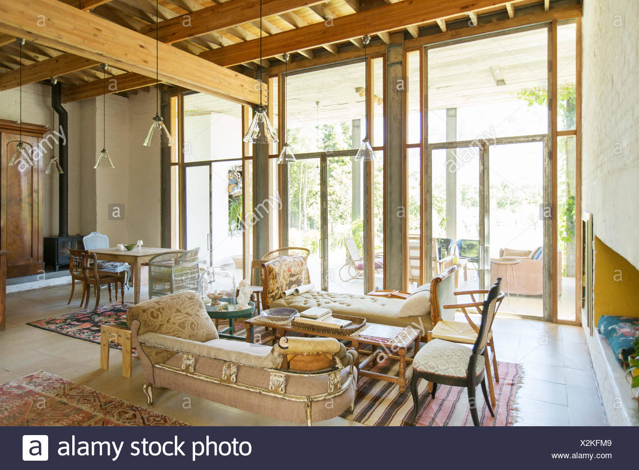 Living and dining area of rustic house - Stock Image