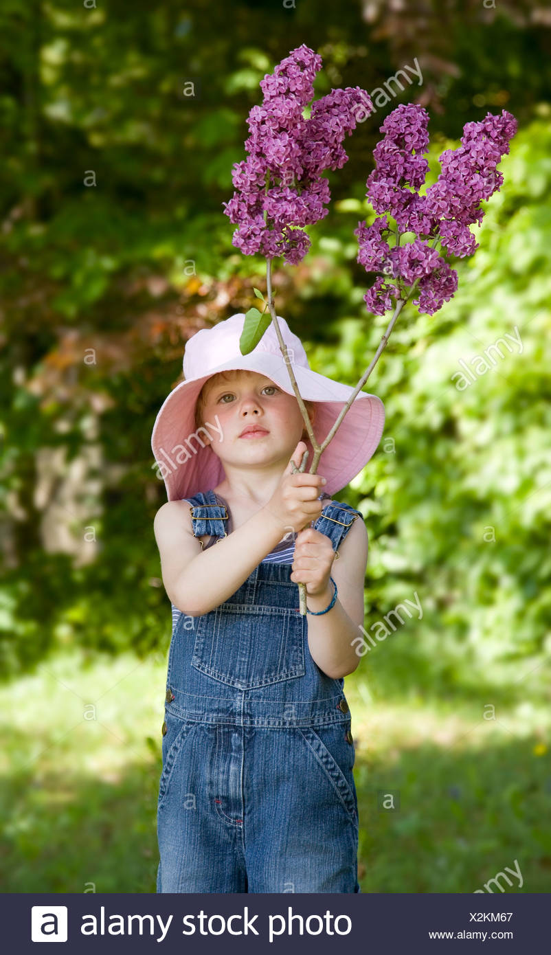 boy holding lilac blossom - Stock Image