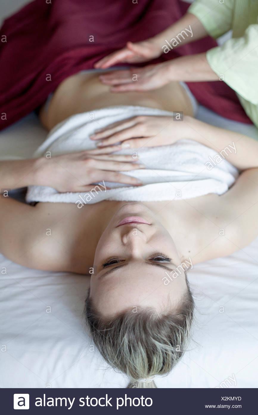Young woman having massage - Stock Image