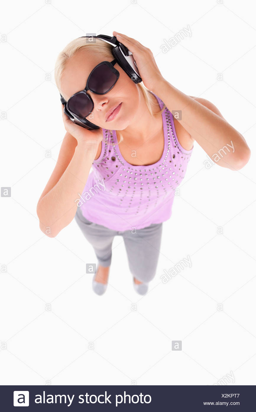 Glorious lady with sunglasses and earphones - Stock Image
