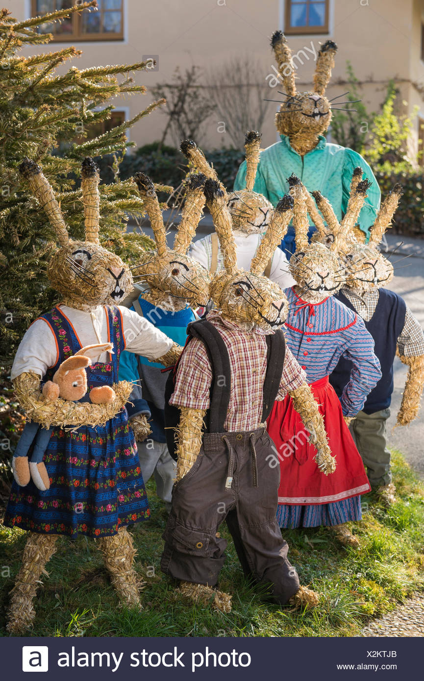 Easter bunnies as straw dolls, schoolchildren with teacher in bunny school, Niederneuching-Ottenhofen, Upper Bavaria, Bavaria - Stock Image