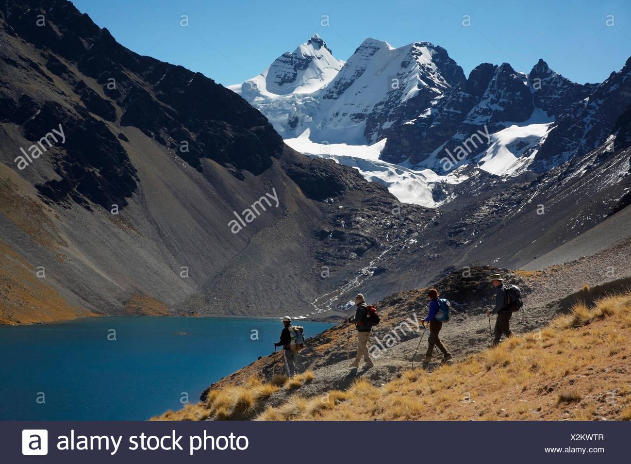 Trekkers With Condorri Peak Behind - Stock Image