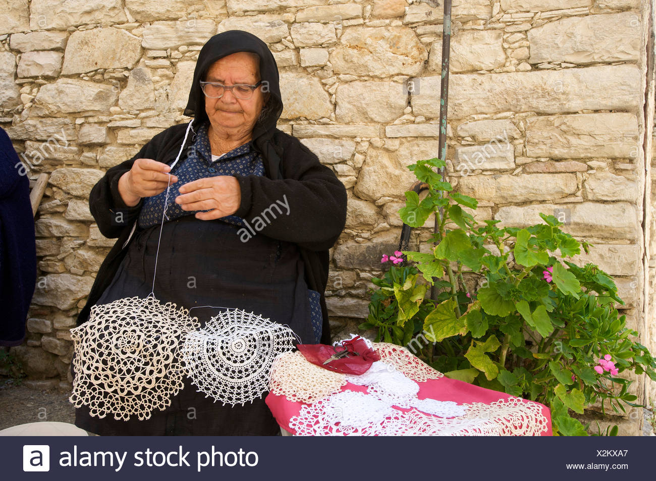 Woman making traditional crochet doilies in Omodos, Troodos Mountains, Southern Cyprus, Cyprus - Stock Image