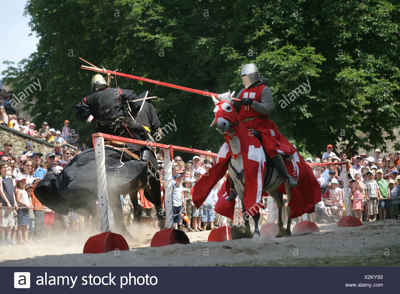 Two knights on horses are fighting with lances at a show on the fortress Ehrenbreitstein near Koblenz, Rhineland-Palatinate - Stock Image