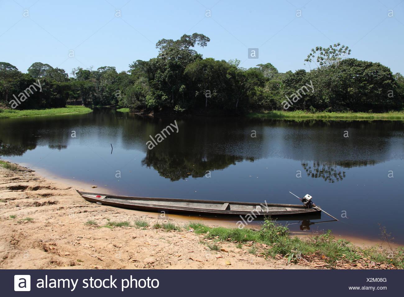 Brazil, Amazonas, Canoe on Amazon river - Stock Image