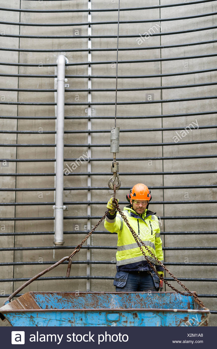 Sweden, Vastmanland, Construction worker standing inside water tower Stock Photo