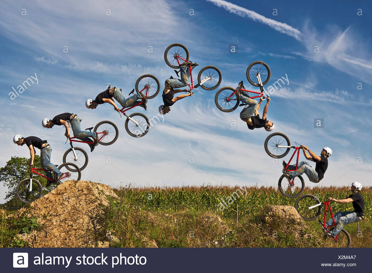 Man performing stunt on bmx bike, digital composite - Stock Image