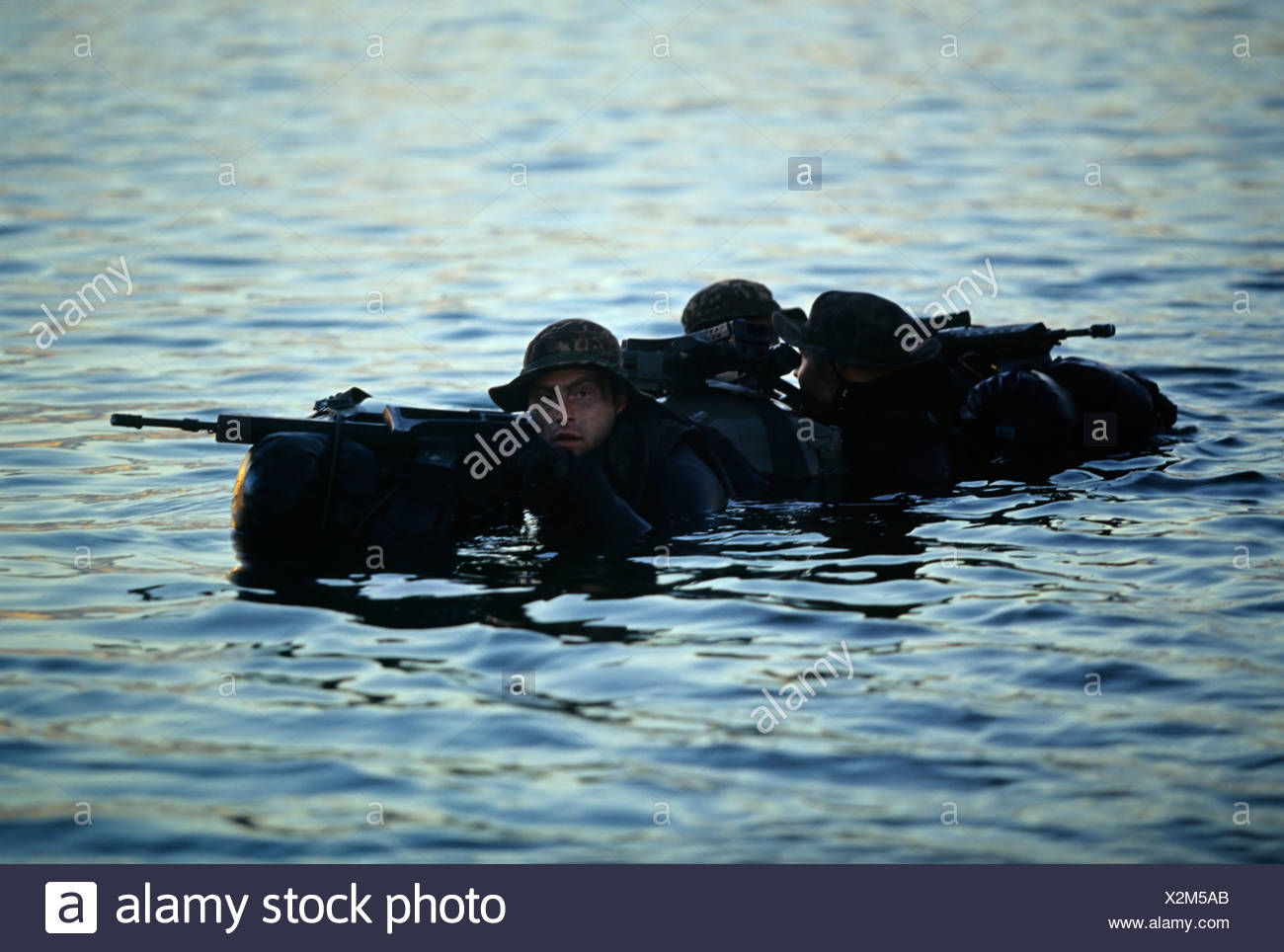 Armed Soldiers of the German special forces 'Kampfschwimmerkompanie' waiting on the surface of the sea for helicopter pickup, E - Stock Image