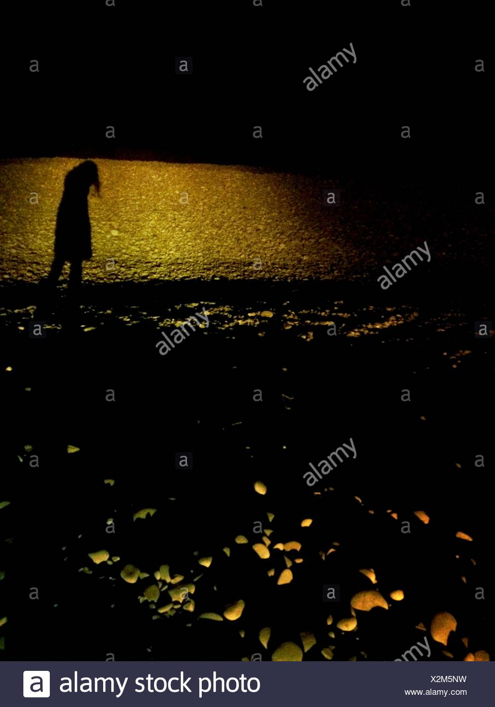 Silhouette Woman On Beach - Stock Image