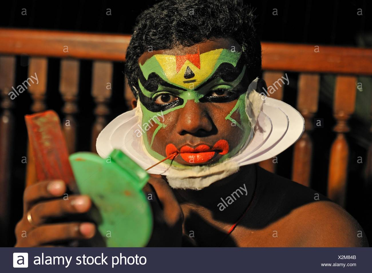 Kathakali performer during making up before a show at the Kumarakom Lake Resort hotel, Kerala state, South India, Asia. - Stock Image