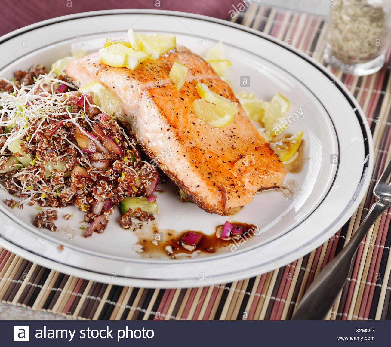 Salmon With Lemon And Red Quinoa Salad Stock Photo Alamy