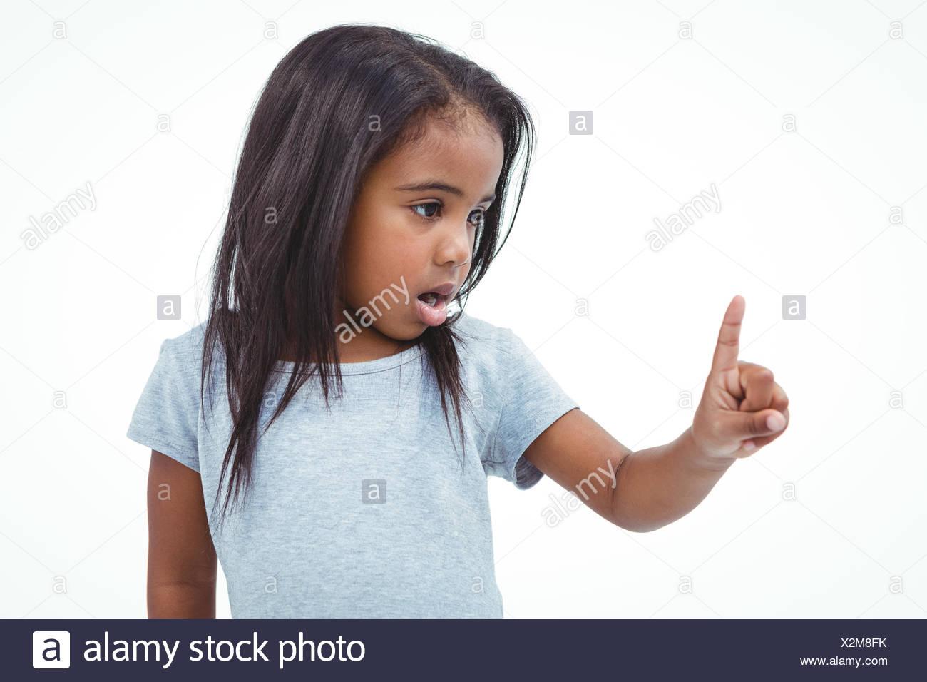 Cute girl shaking finger saying no - Stock Image