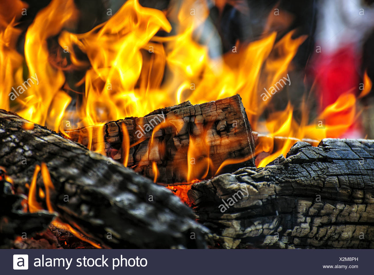burning charcoal on a grill - Stock Image