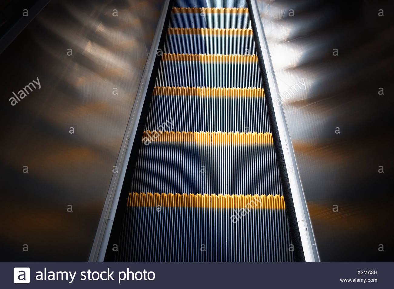 Close up, looking down moving escalator. - Stock Image