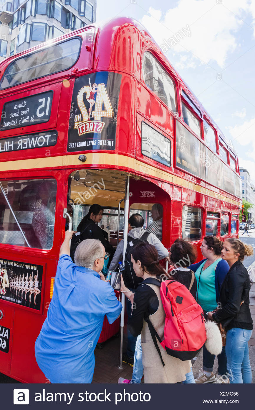 England, London, Passengers Boarding Vintage Routemaster Doubledecker Red Bus - Stock Image