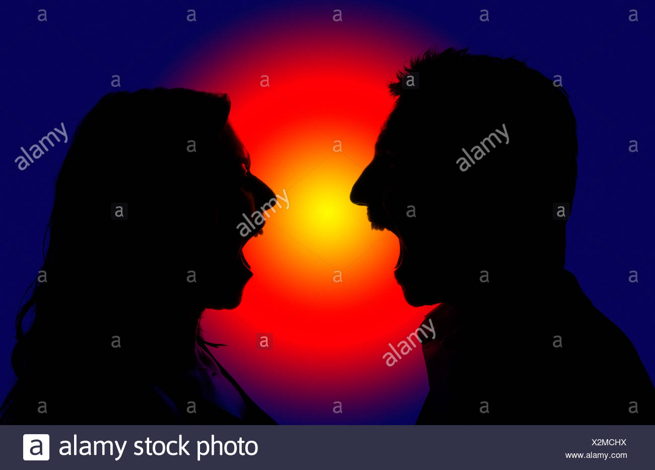 A man and a woman yelling at each other, silhouette against a red and blue light - Stock Image