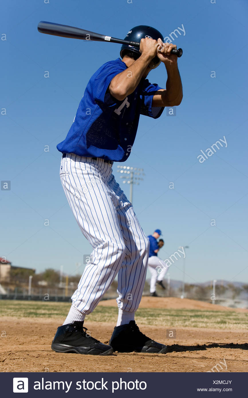 Baseball batter facing pitcher during competitive game, focus on foreground, rear view Stock Photo