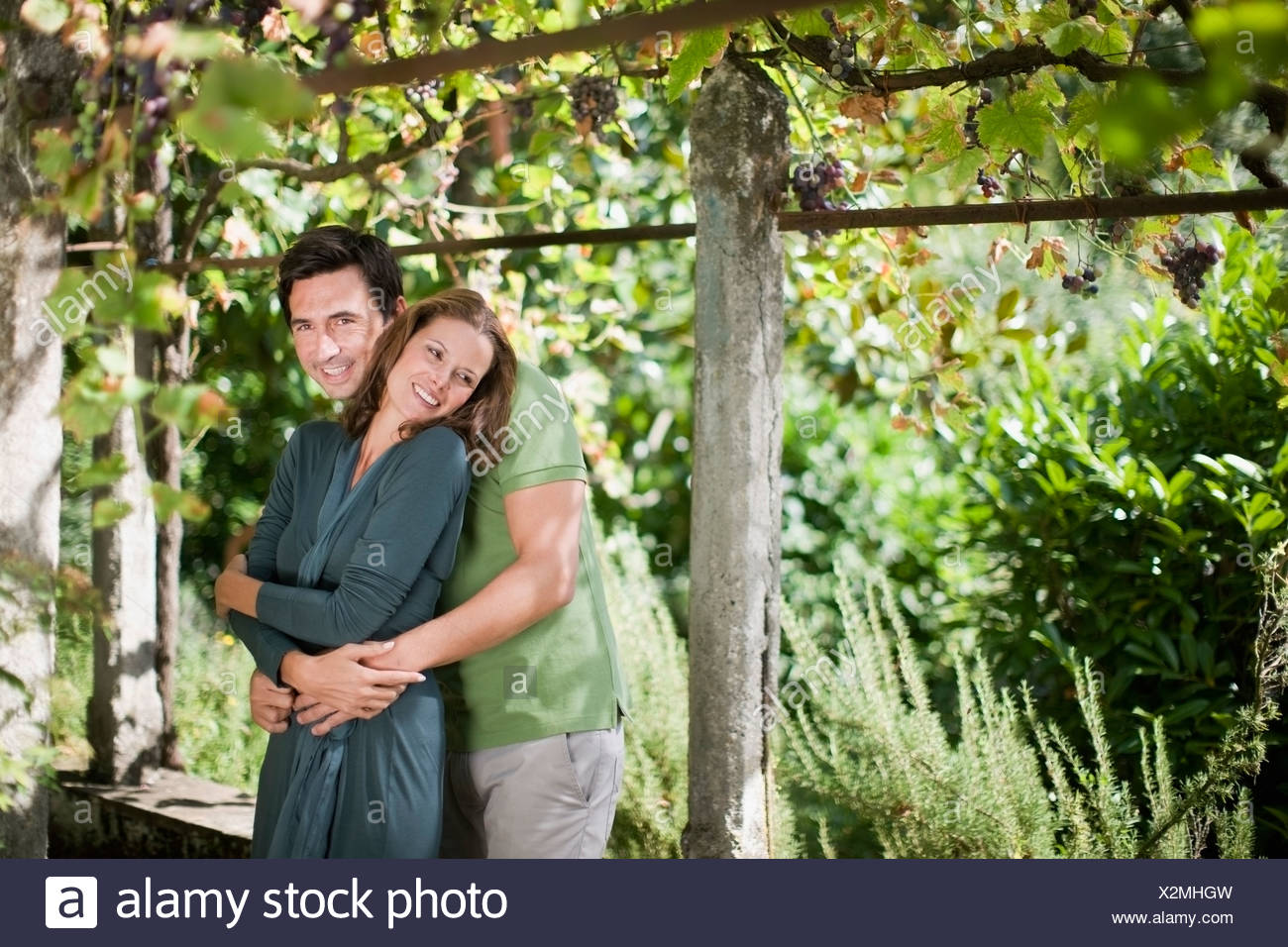 Two lovers hugging in nature - Stock Image