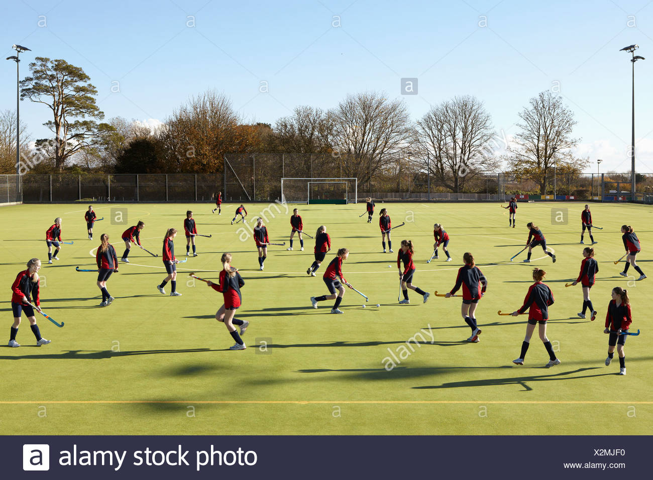 Lacrosse players in game on field Stock Photo