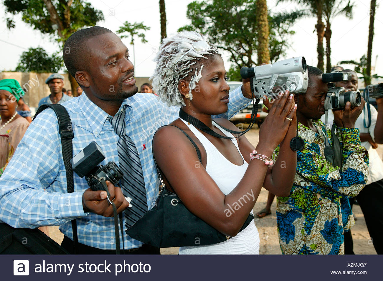 Photographer showing woman how to operate a video camera, Douala, Cameroon, Africa - Stock Image