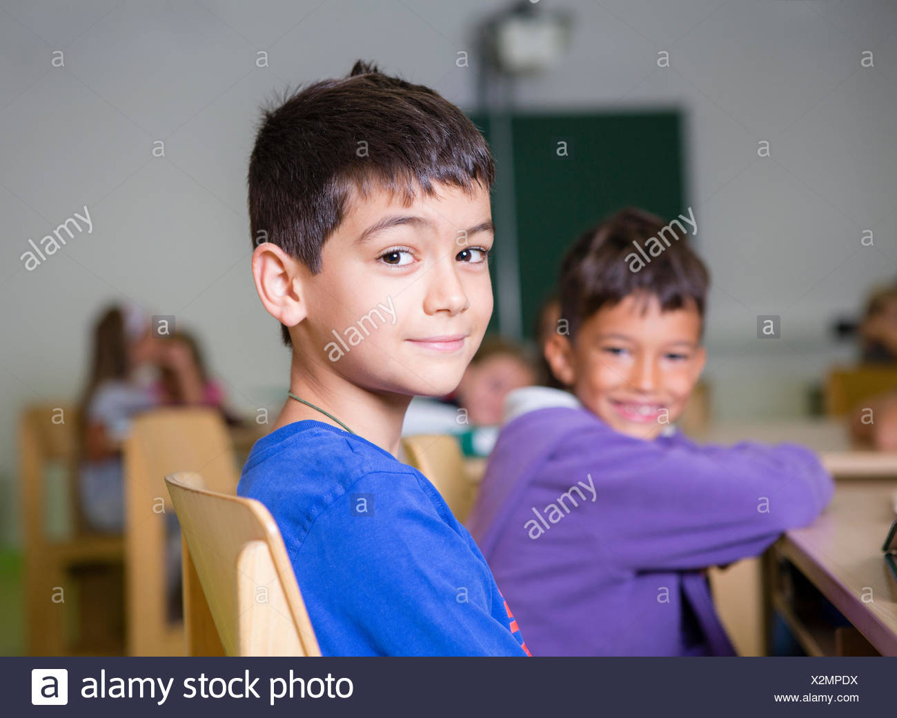 Elementary school children with an immigrant background sitting in a primary school class, Reith im Alpbachtal - Stock Image