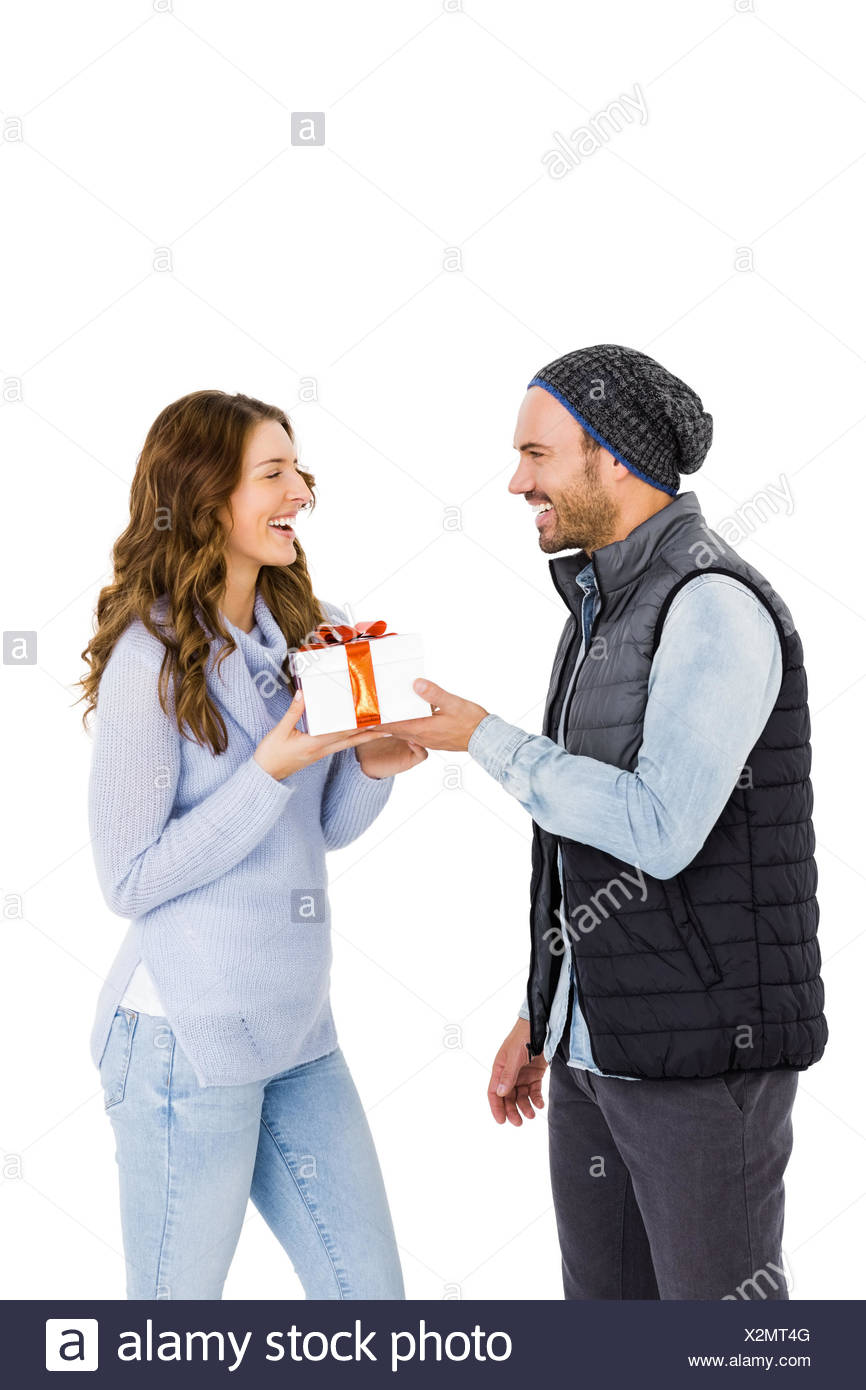 Man giving gift to woman - Stock Image