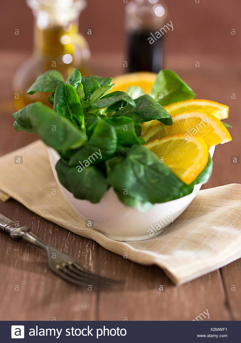 Lamb's lettuce with oranges Stock Photo
