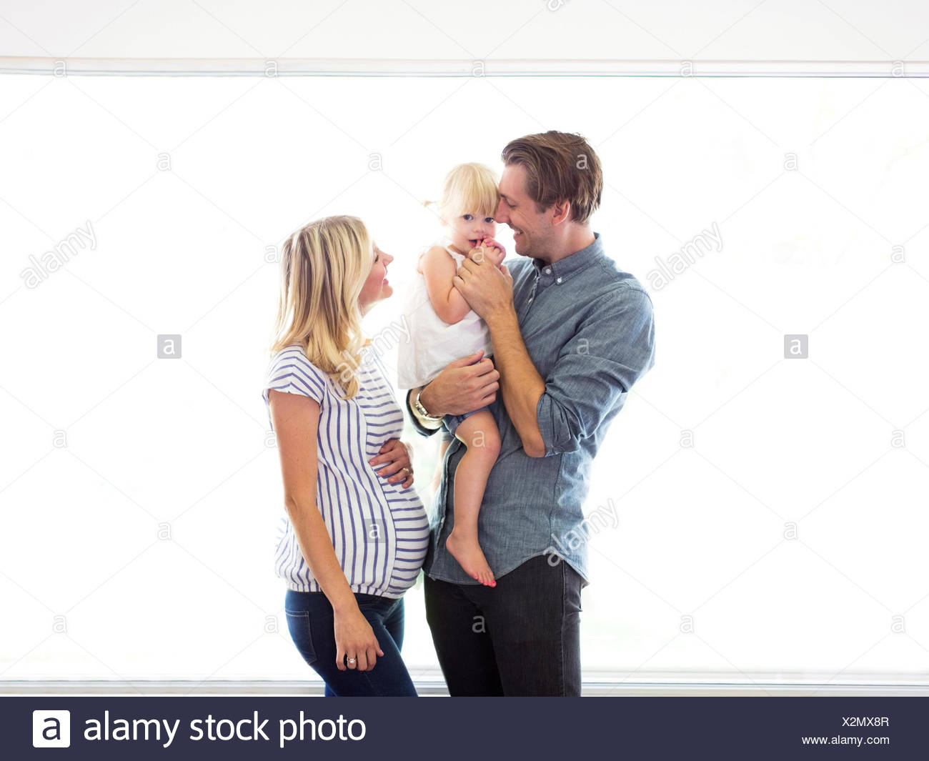Family portrait of parents with daughter (2-3) - Stock Image