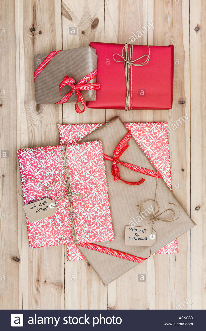 Christmas Gift Packages.Christmas Gift Packages On Wooden Floor Stock Photo