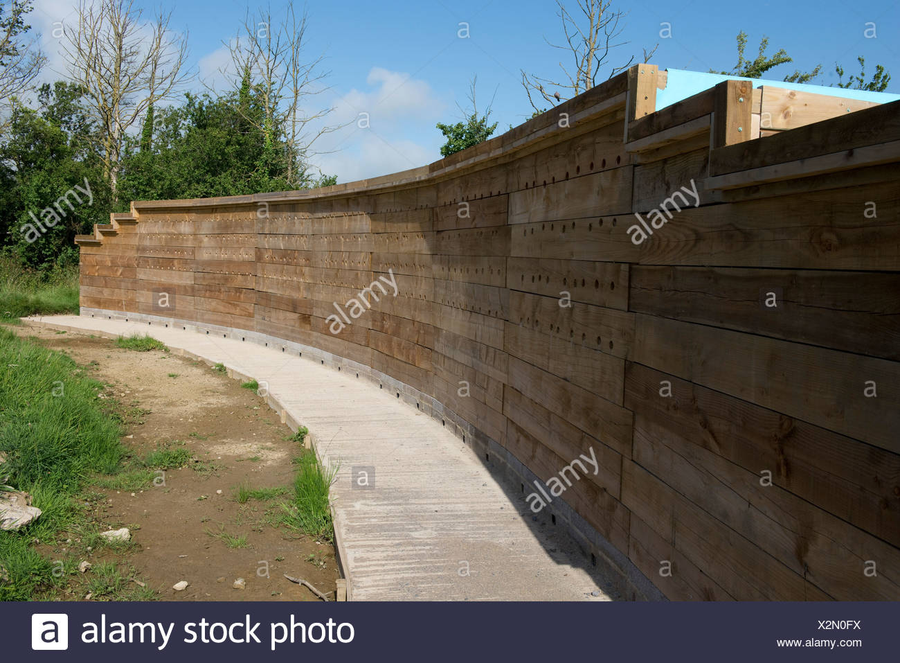 A wooden artificial sand martin bank and bat roost at the East Devon Axe Estuary Wetlands Nature Reserve near Seaton in Devon - Stock Image
