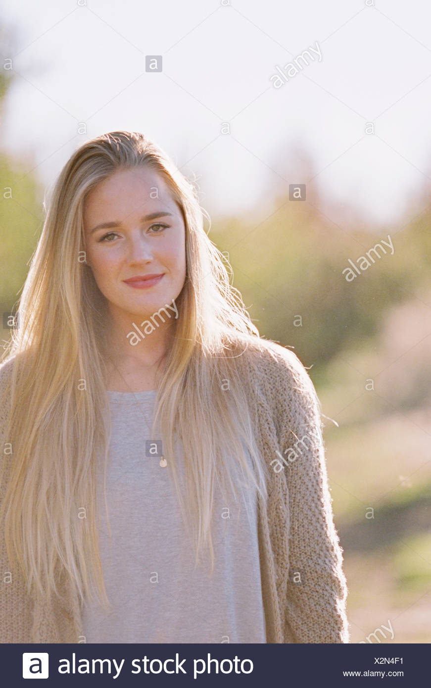Portrait of a woman with long blond hair. - Stock Image