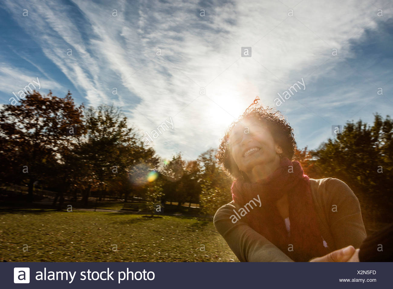 Young woman in park on autumn day Stock Photo