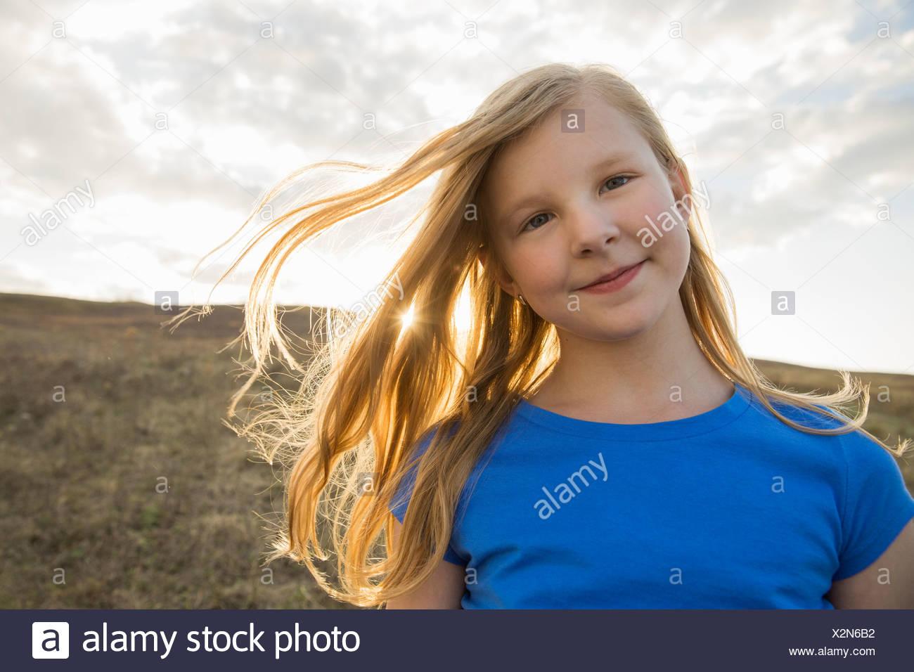 Portrait of schoolgirl looking at camera - Stock Image